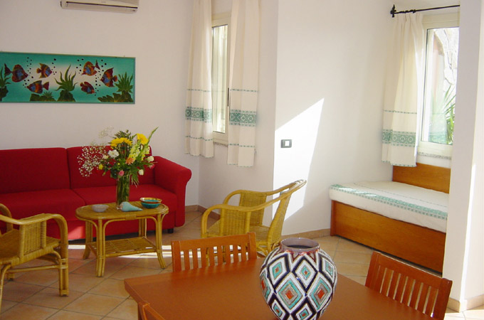 an example of a living-room of an apartment of Residence la Chimera in Villasimius, for your holidays in Sardinia